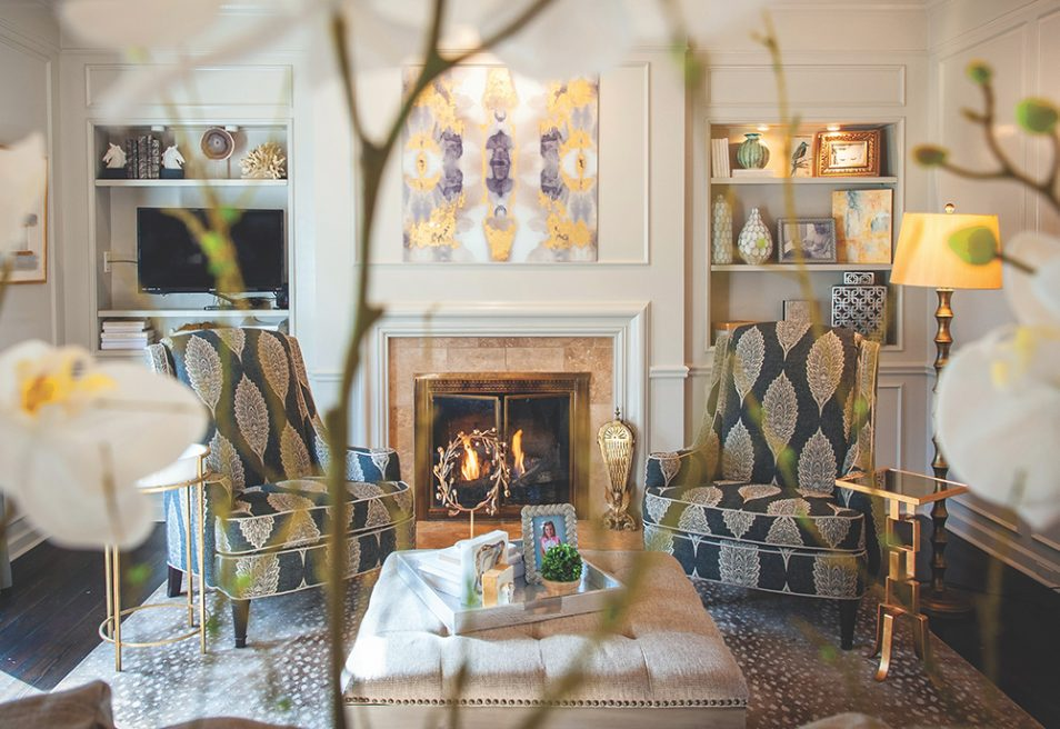 The fireplace in the living room makes it as cozy and well-used a space as the family room. Patterns play off each other, offering an abundance of visual interest.